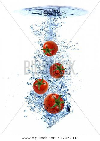 Fresh cherry tomatoes dropped into the water