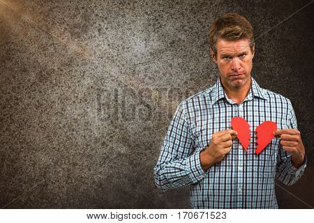 Sad man with broken heart against close-up of road surface
