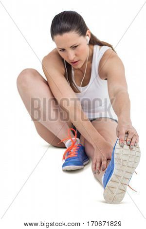 Athlete woman stretching her hamstring on white background