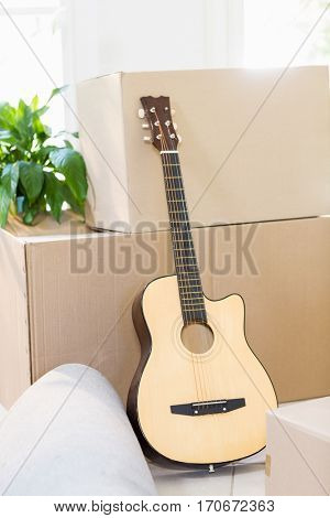 Guitar and cardboard boxes in a new home