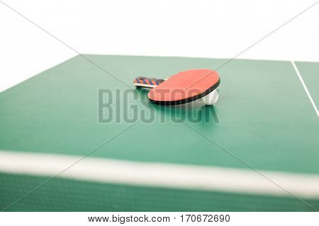Table tennis racket with a ball on a table tennis table