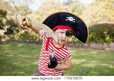 Little boy pretending to be a pirate in the park