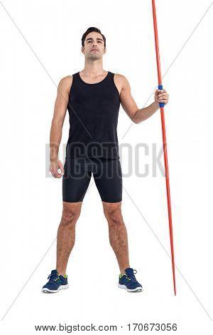 Confident male athlete holding javelin on white background