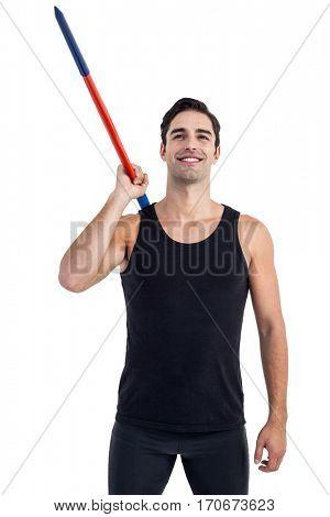 Happy male athlete holding javelin on white background