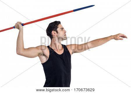Male athlete preparing to throw javelin on white background