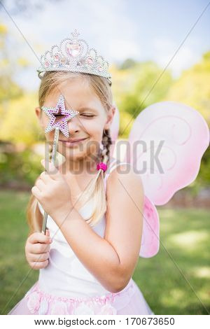 Cute girl pretending to be a princess in the park