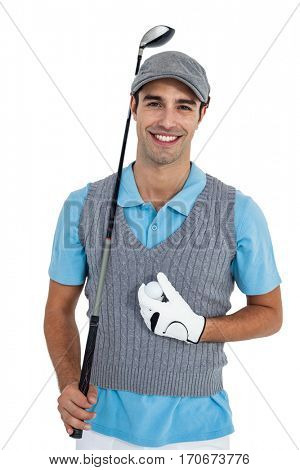 Portrait of golf player standing with golf ball and golf club on white background