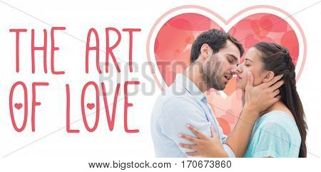 Attractive young couple about to kiss against web