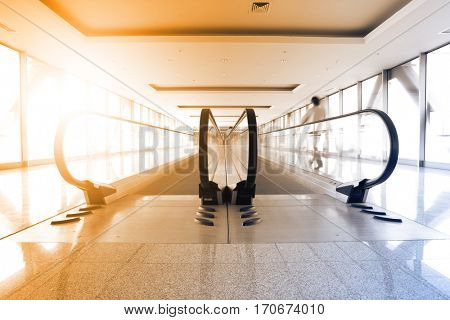 Perspective of corridor and escalator in airport. Toned image
