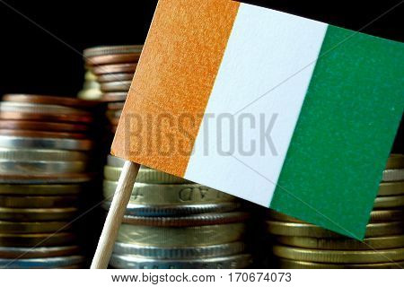 Ivory Coast Flag Waving With Stack Of Money Coins Macro