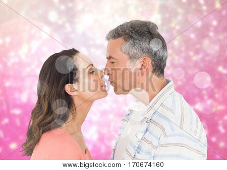 Romantic couple rubbing nose against digitally generated background