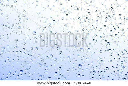 Rain water drops on windows glass
