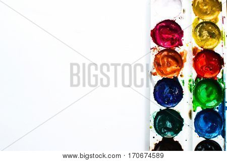 Paint lay on the black surface pretty lights background creativity