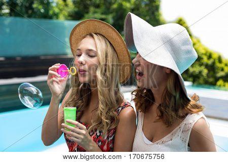 Beautiful blowing bubble wand near pool