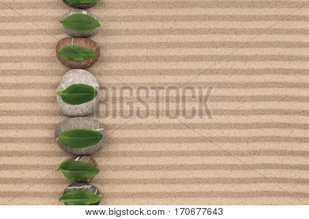 leaves lying on the stones have been laid out in a row on the sand with space for text. View from above