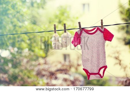 Baby girl clothes hanging on the clothesline.
