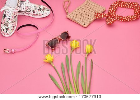 Fashion Spring girl clothes set, accessories. Summer Hipster style.Design Trendy sunglasses, floral hipster gumshoes. Fashion Handbag clutch, spring flower.Summer Urban woman look.Perspective view