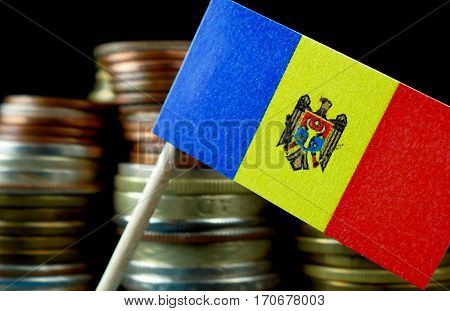 Moldova Flag Waving With Stack Of Money Coins Macro