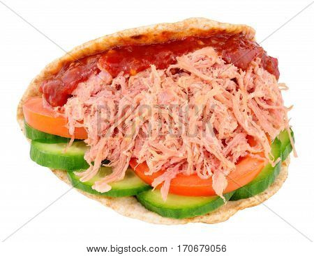 Shredded ham salad sandwich in a folded wholemeal flatbread isolated on a white background
