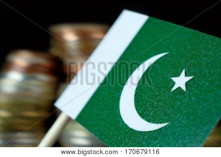 Pakistan Flag Waving With Stack Of Money Coins Macro