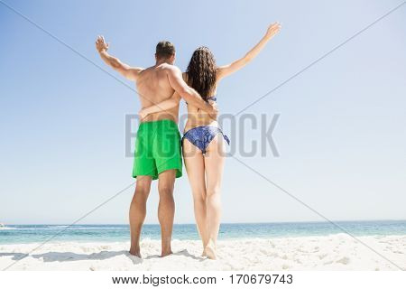 Couple with arm around each other at the beach