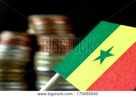 Senegal Flag Waving With Stack Of Money Coins Macro