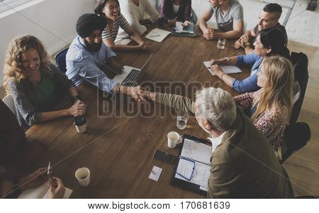 Diverse people teamwork on meeting table