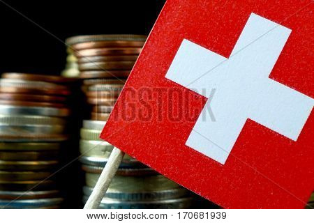 Switzerland Flag Waving With Stack Of Money Coins Macro