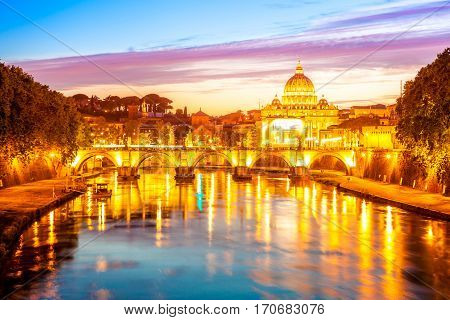 Rome skyline at evening with San Pietro basilica illuminated by city lights of Rome, Italy.