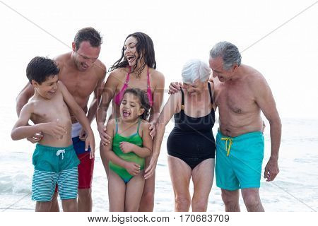 Front view of happy family enjoying on sea shore at beach