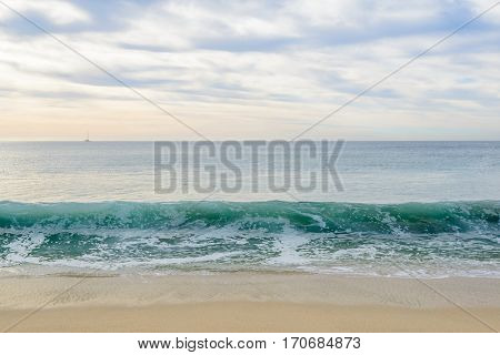 Set of six pictures of a fantastic ocean wave in different stages. Cloudy sunrise sky. San Jose del Cabo. Mexico.