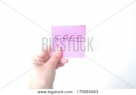 Hand holding handwritten FREE sign