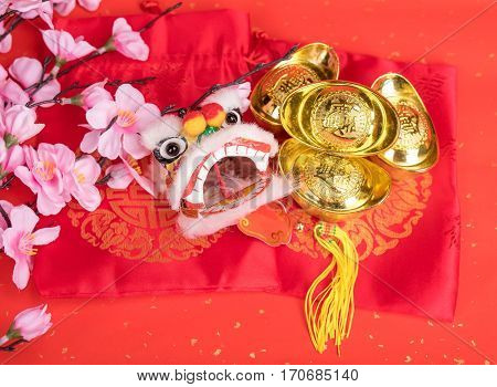 chinese traditional dancing lion with Gold ingot,Chinese calligraphy Translation:good bless for money