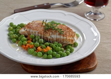 Roasted Atlantic halibut fillet with vegetables and red wine
