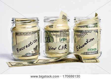 Jars with dollar bills. Money collected for use.