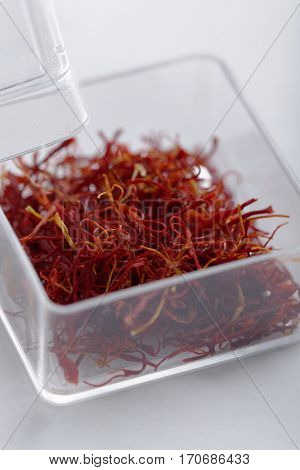 Dried saffron stigmas in the box closeup