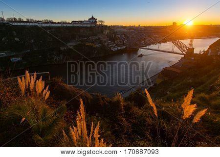 Douro river and Dom Luis I bridge at sunset, Porto, Portugal.