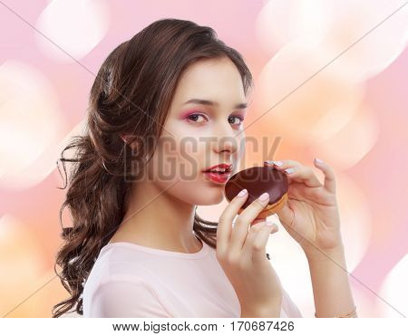 beautiful young model eating dessert, isolated