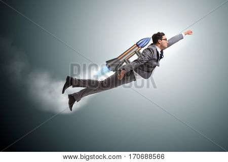 Man flying with the rocket in business concept