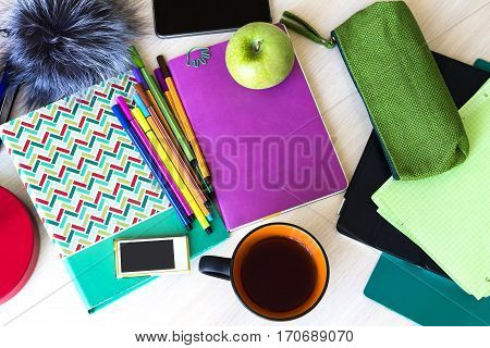 student education kit (set): notebook pen pencil case gadget cup. Top view (flat lay)