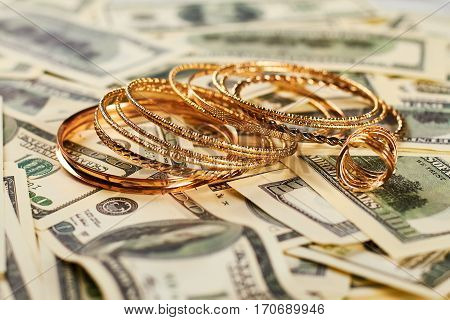 Golden jewelry and money. Expensive and unrighteous lifestyle.