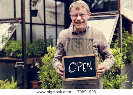 Mature Open Sign Garden Shop