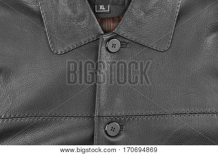 Texture of men's leather jacket size XL. View from above