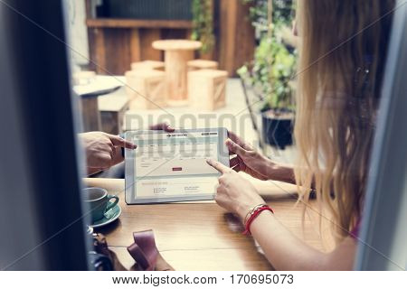 Couple using digital tablet in a cafe