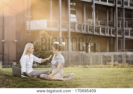 Young businesswomen discussing in office lawn