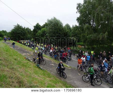 Hamburg, Germany - June 19, 2016: A large crowd of bicycle riders on a country road. Demonstration for development of ecological transportation. The event is called Fahrradsternfahrt.