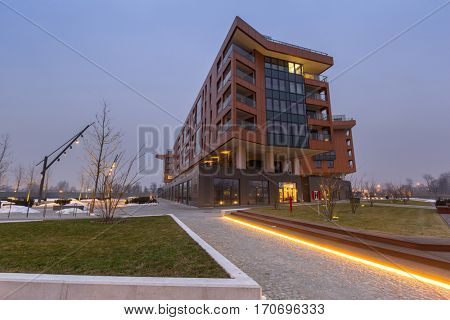 GDANSK, POLAND - FEBRUARY 2, 2017: Architecture of modern apartments at Motlawa river in Gdansk, Poland. Riverside buldings are situated in the city center across the old town of Gdansk.
