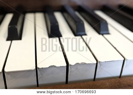 Old vintage piano with ebony and ivory keys black and white playing music