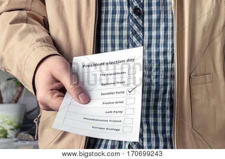 Election day in France. Voter holds ballot with selection of the candidate from France's Socialist party.