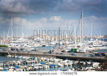 Harbor View With White Yachts And Cathedral